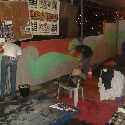 Jovens do CMJ botam a 'mão na massa' no Complexo do Alemão